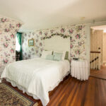 double bed in room 3, pink flowery wallpaper
