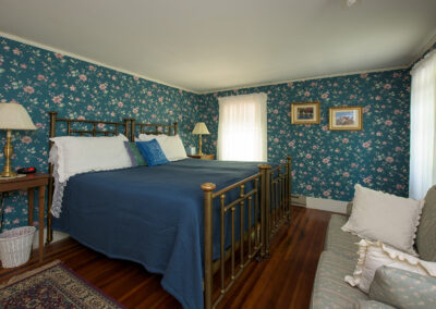 two single beds in room 4, blue wallpaper