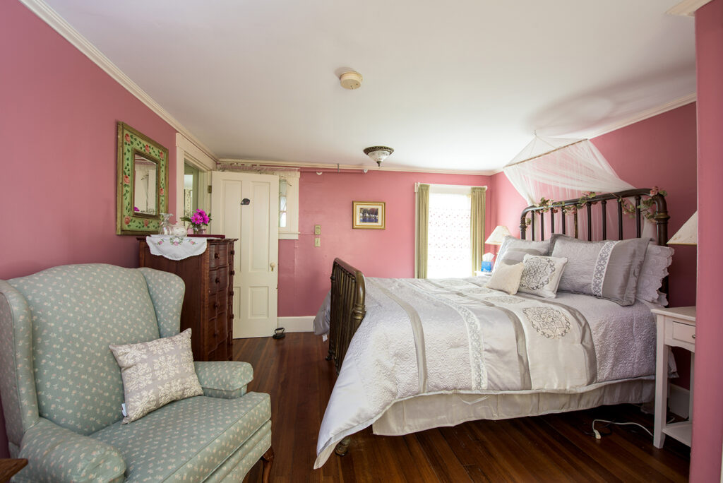 double bed in room 5, pink walls