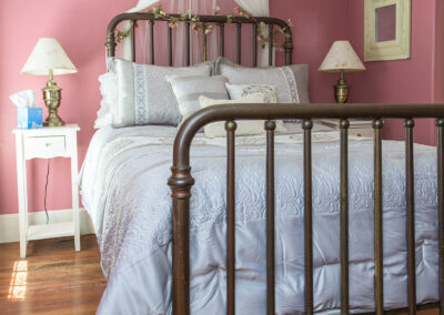 single bed in room 5, pink walls