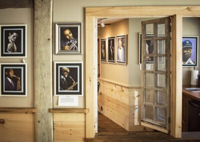 picture of barn hallway with musician artwork on wall