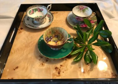 Three tea cups and mint on serving tray